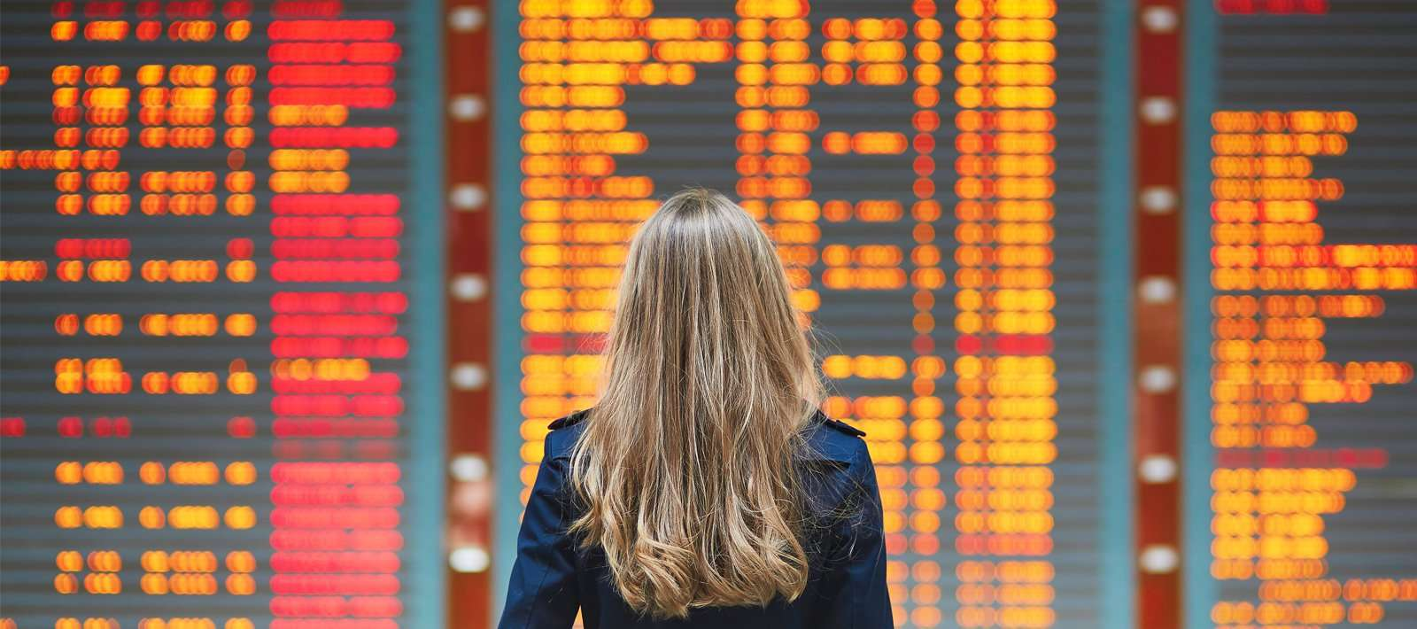 woman looks at boarding infromation